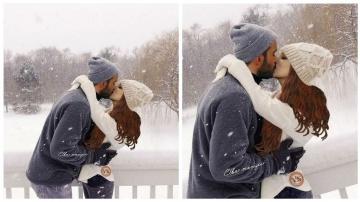 Барыш Ардуч поцеловал Эльчин Сангу на фоне зимы.
